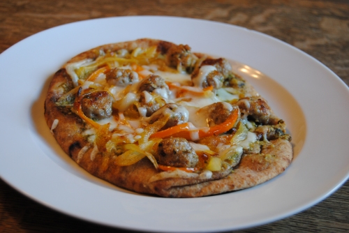 Delicous Italian sausage and pepper pizza