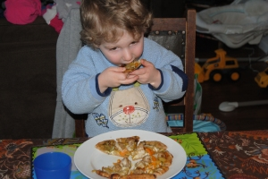Toddler eating pizza